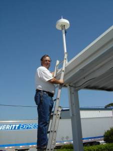 Joe Weaver from Ashtech fine tuning the CORS antenna